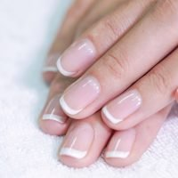 Here's what the state of your nails says about your health (and what those white spots mean)