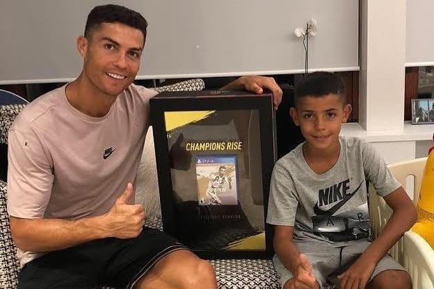 Cristiano Ronaldo proudly shows off world's first copy of Fifa 19 alongside son