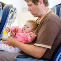 From changing nappies in the cabin tokidssnotting all over strangers, the grossest things that parents have to deal with on flights