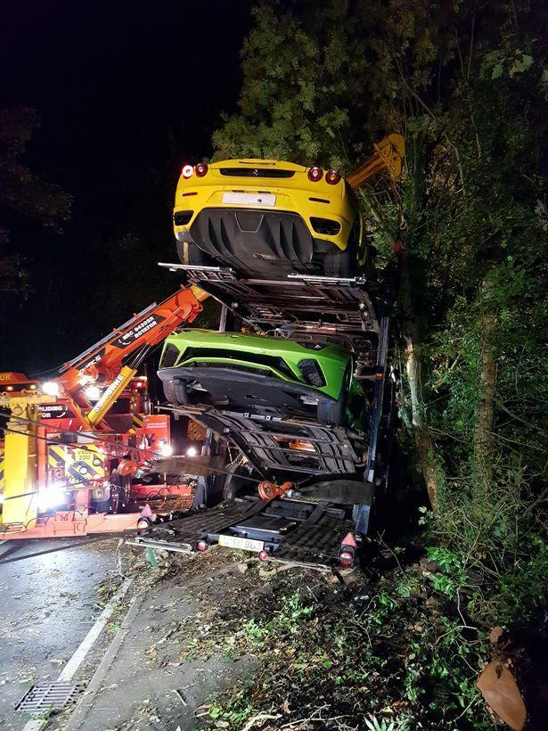 Supercar 'flung into tree' after lorry carrying £2m of Ferraris, Lamborghinis and Aston Martins crashes