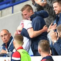 Stephen Darby celebrates with Bolton goalscorer Craig Noone after Motor Neurone Disease diagnosis