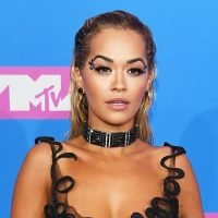 Rita Ora Flaunts Her Bikini Body In A String Black Two-Piece