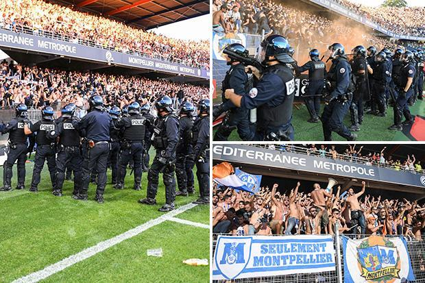 Montpellier fans SPRAYED by riot police after fence collapse as derby clash with Nimes is delayed by more than 30 minutes