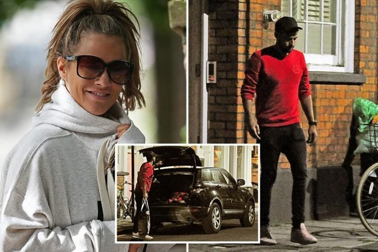 Andrew Brady moves his stuff back into Caroline Flack's house after the pair get back together