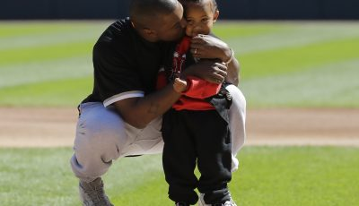 Kanye West and son Saint throw first pitch at Chicago White Sox game