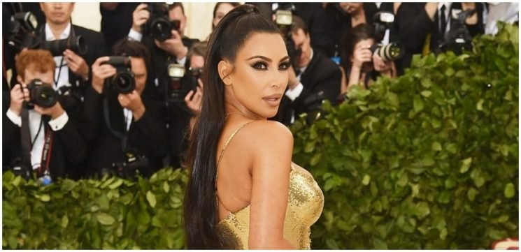 Kim Kardashian Celebrates Billion-Dollar Deal With Money Themed Ensemble