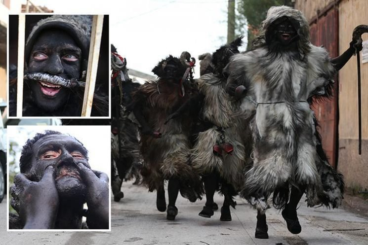 Turkish men covered in soot and sheepskin celebrate independence festival called Tülütabaklar