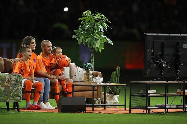 Holland hero Wesley Sneijder watches career highlights from sofa on pitch in final international game