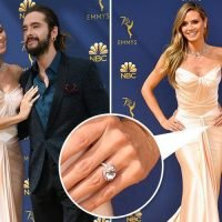 Heidi Klum sparks rumours she's ENGAGED to toyboy Tom Kaulitz after showing off enormous diamond ring at 70th Emmy Awards