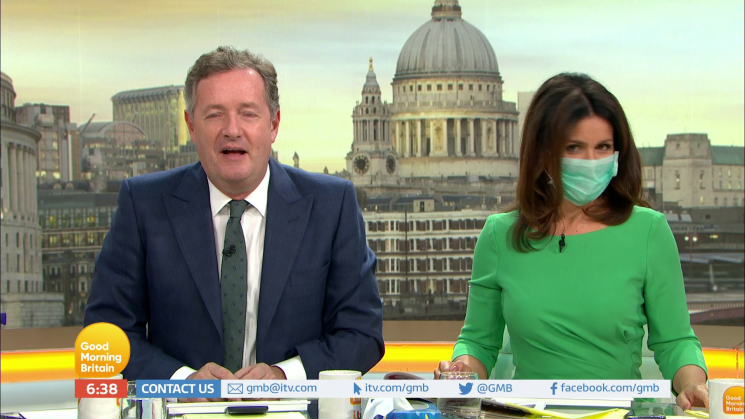 Piers Morgan takes a swipe at Susanna Reid's love life as she wears a surgical mask to avoid his germs