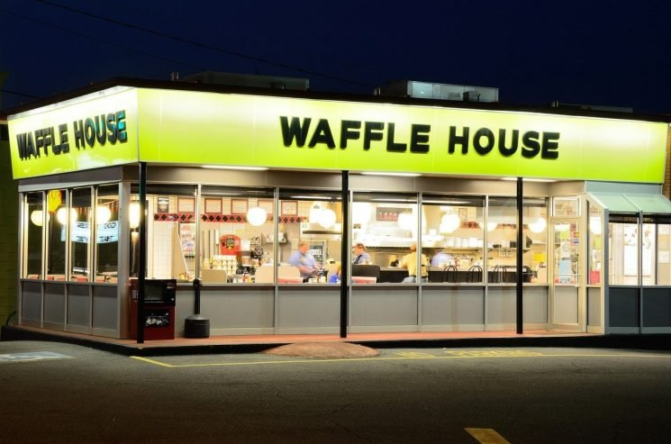 Waffle House customer confronted by police officers for bringing live snake into restaurant