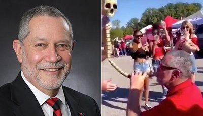 College president apologizes for viral video of him drinking from beer bong while tailgating