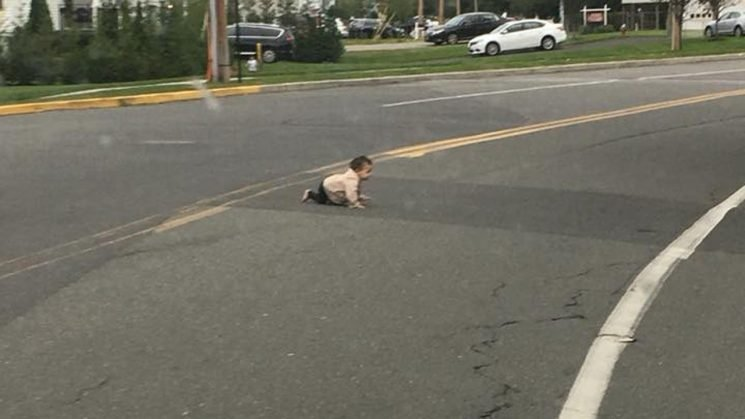Dad charged after baby found crawling across New Jersey road
