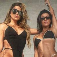 Kourtney Kardashian shows off impressive bikini body after firing back at fan