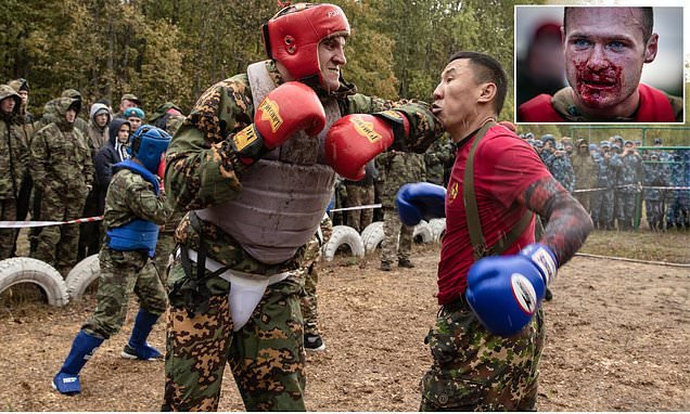 Russian soldiers batter each other in bloody boxing bouts