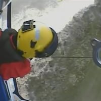 Aerial footage shows RNLI helicopter crew winching glider pilots