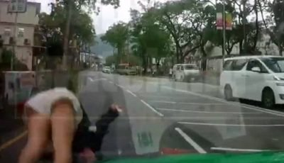 Teenage girl casually walks away from a brutal collision with a taxi