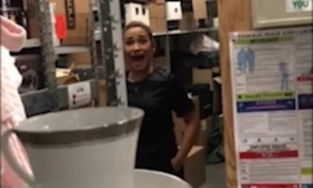 Storm in a teacup! Woman yelps after being spooked by co-worker