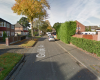 Girl, 14, held at gunpoint and dad attacked with axe during terrifying raid on Manchester home