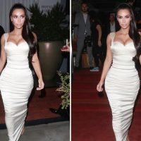 Kim Kardashian wears plunging white gown as she's honoured at LA awards ceremony for saving two lives