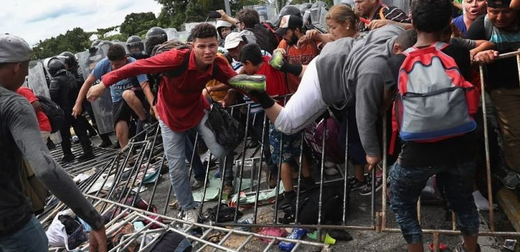 Honduras Caravan Breaks Through Mexico Border In Chaotic Scene