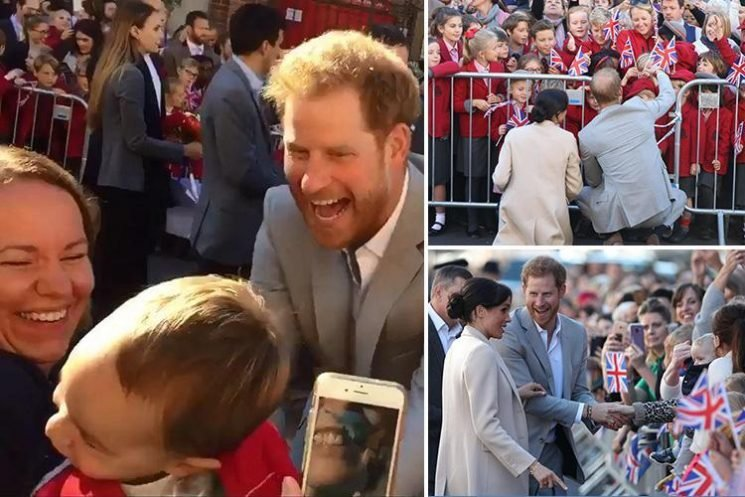 Adorable moment Prince Harry playfully tickles boy, 2, as he meets adoring crowds on Sussex trip with Meghan