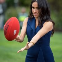 Pregnant Meghan Markle Plays Football — in Heels!