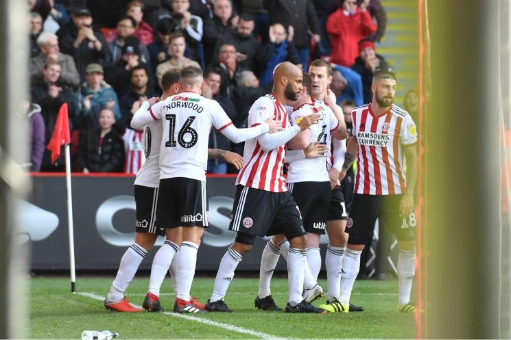 Sheffield United 1 Hull City 0: David McGoldrick fires Chris Wielder's men to top of the Championship