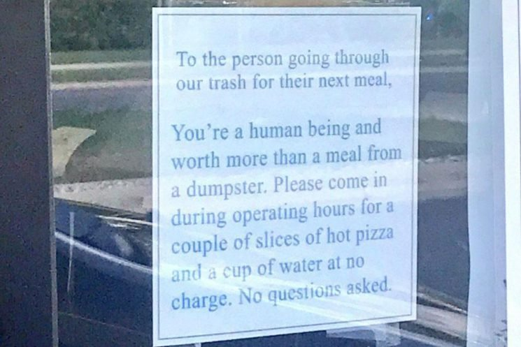 Pizza restaurant's note on door goes viral after staff find homeless people eating from bins outside