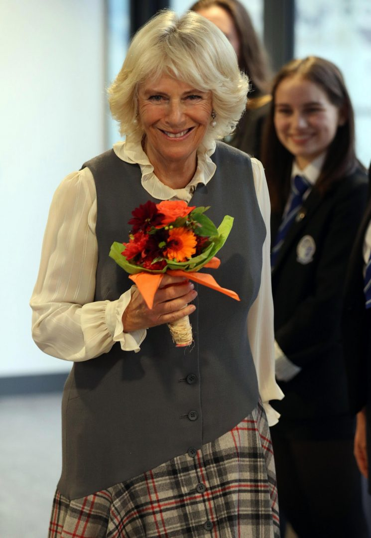 Why is Camilla Parker Bowles not at Princess Eugenie's wedding today?