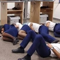 Shocking picture shows Ryanair crew 'sleeping on airport FLOOR' after being stranded by storm