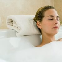 Having a hot bath twice a week is 'BETTER than exercise' for easing depression