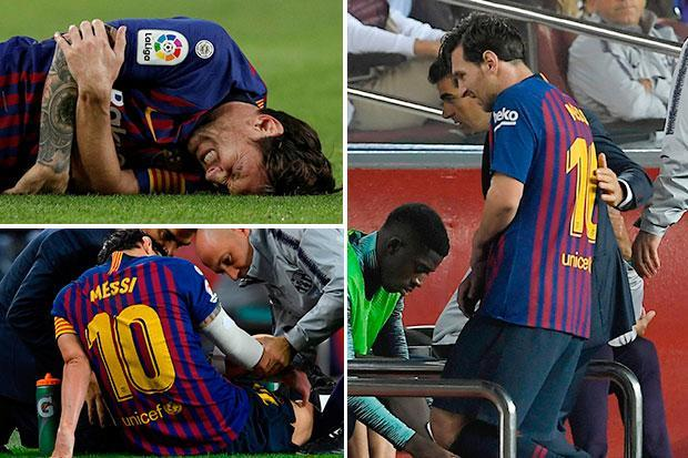 Lionel Messi injured during Barcelona's game against Sevilla and leaves pitch holding his arm