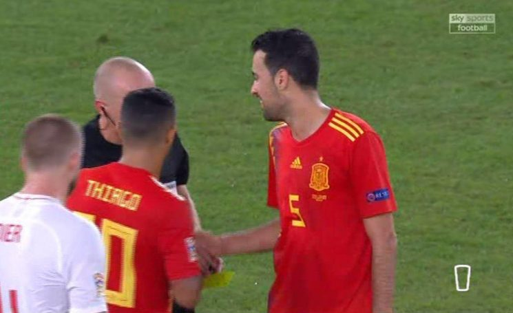 Spain midfielder Sergio Busquets throws the ball at referee Szymon Marciniak after he blows final whistle in England win