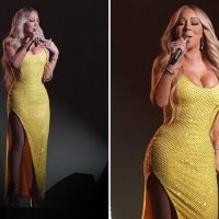 Mariah Carey looks very busty in a yellow gown slashed to the thigh as she performs in Japan
