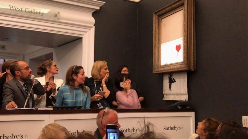 'Going, Going, Gone'! $1.4 Million Banksy Painting Self-Destructs Right After Being Auctioned Off
