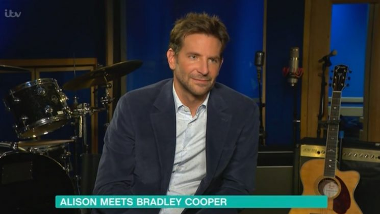 Bradley Cooper Doesn't Seem Impressed as TV Host Sings During Awkward Interview