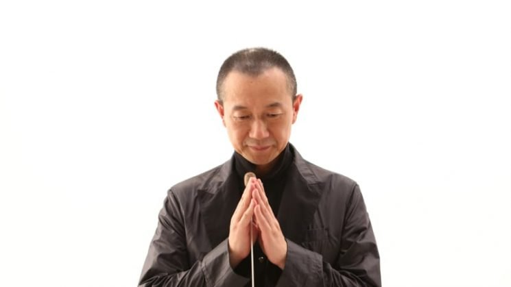 Orchestral transition from Bach to Buddha, from Passion to Nirvana