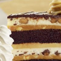 PSA: The Cheesecake Factory Is Giving Out FREE Slices of Reese's and Hershey's Cheesecake This Halloween