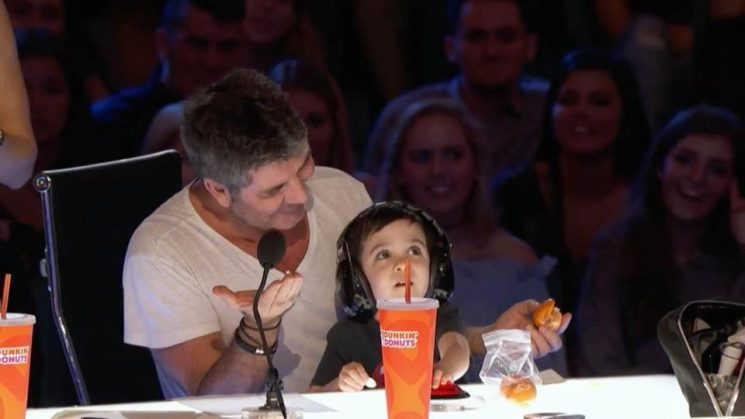 How old is Simon Cowell's son Eric and when did he appear on The X Factor and BGT?