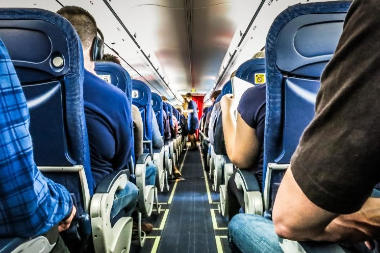 First-Time Flyer Mistakes Emergency Exit for Bathroom and Attempts to Open Door Mid-Flight