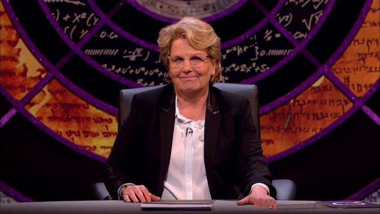 What time is QI on BBC Two tonight and who is appearing with Sandi Toksvig and Alan Davies?
