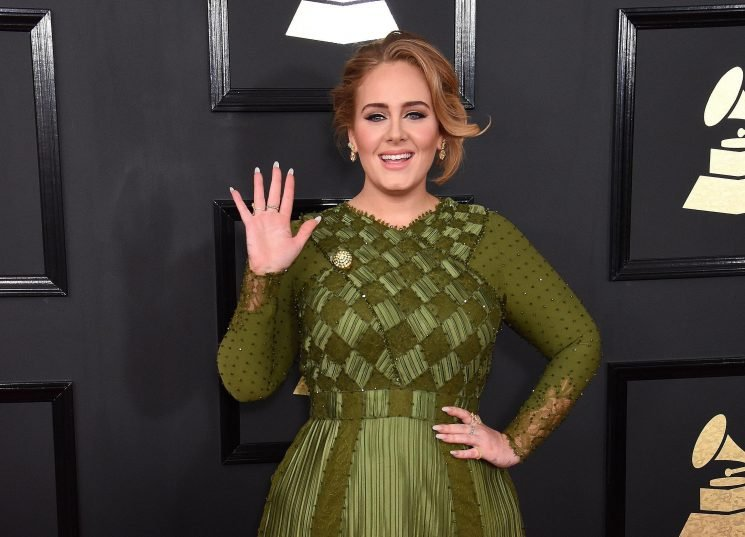 What is Adele's net worth, when was her son Angelo born and what are her biggest songs?
