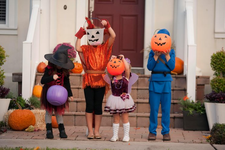 How did trick or treating start, what's the meaning behind the phrase and how is it done around the world?
