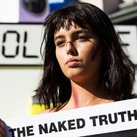 PETA Protesters March Topless In NYC Against Canada Goose's Use Of Fur: See Powerful Pics