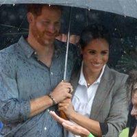 Meghan Markle Sweetly Holds Prince Harry's Umbrella in the Rain