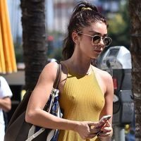Sarah Hyland Goes Braless & Shows Nipples In Bright Yellow Halter Dress