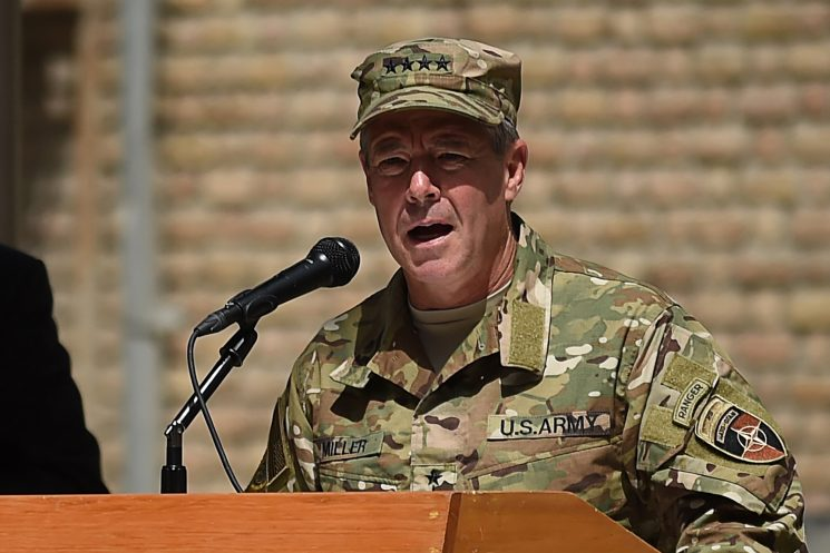 US commander unscathed in shooting that killed top Afghan official