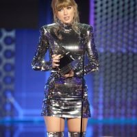 Taylor Swift Urges Fans to 'Get Out and Vote' While Accepting Artist of the Year at AMAs