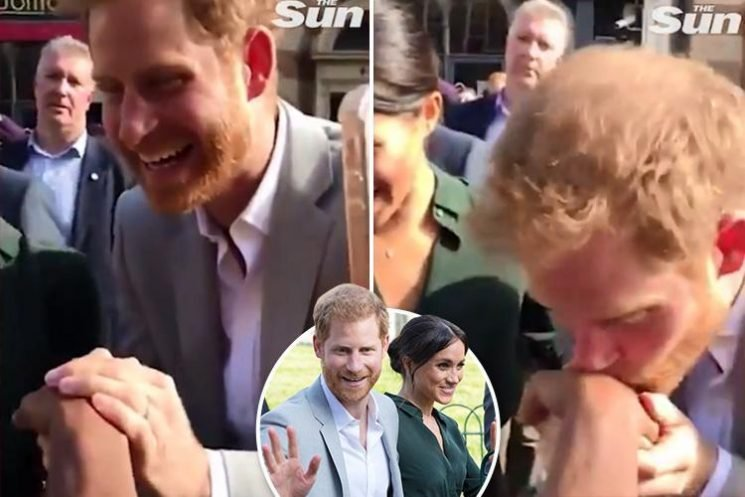 The sweet moment Prince Harry breaks protocol to KISS a surprised female fan's hand in Sussex